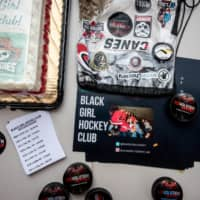 Paraphernalia for the Black Girl Hockey Club is laid out at a Carolina Hurricanes' game at PNC Arena in Raleigh, North Carolina, on Feb. 16. | KATE MEDLEY / THE NEW YORK TIMES