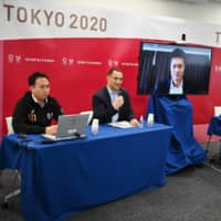 U.S. Open wheelchair tennis champion Shingo Kunieda (center) speaks during a news conference at Tokyo 2020 headquarters on Friday. | AFP-JIJI
