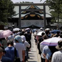 Abe visits war-linked Yasukuni Shrine for first time since 2013