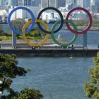 The Olympic rings are seen in Tokyo's Odaiba waterfront district on March 24.   AP