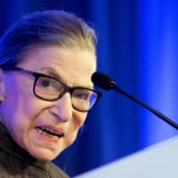 U.S. Supreme Court Justice Ruth Bader Ginsburg speaks after receiving the American Law Institute's Henry J. Friendly Medal in Washington in 2018. | AFP-JIJI