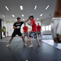 A training session at China's only bodyguard school | AFP-JIJI