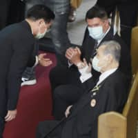 Former Prime Minister Yoshiro Mori (center) is seated next to U.S. Undersecretary of State Keith Krach at a memorial service for the late Taiwanese President Lee Teng-hui in Taipei on Saturday. | POOL / VIA AP