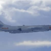 A Chinese People's Liberation Army H-6 bomber is seen flying near Taiwan's air defense identification zone on Friday. | TAIWAN MINISTRY OF NATIONAL DEFENSE / VIA AP