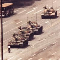 A man stands in front of a convoy of Chinese military tanks in the Avenue of Eternal Peace in Beijing on June 5, 1989, in the wake of the Tiananmen Square crackdown on pro-democracy protests. | REUTERS