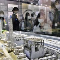 An exhibit shows a model of the damaged Fukushima No. 1 nuclear power plant at The Great East Japan Earthquake and Nuclear Disaster Memorial Museum in Futaba, Fukushima Prefecture, on Sunday. | KYODO