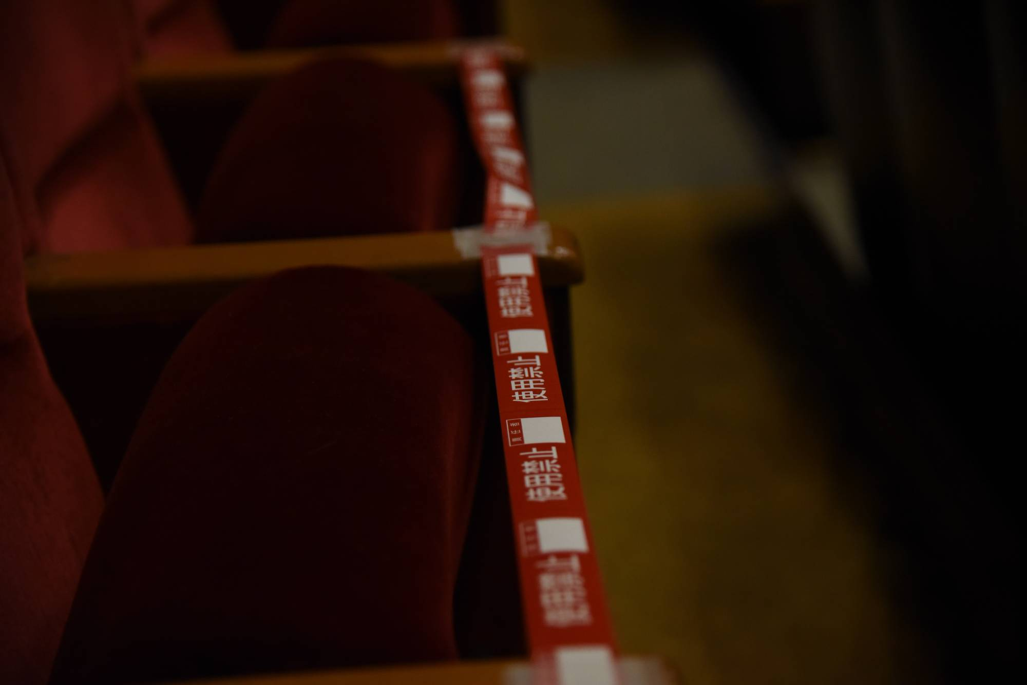 Seats in Ryogoku Kokugikan are blocked off by tape to ensure physical distancing. | DAN ORLOWITZ