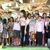 Children living in poverty take part in a fashion show organized by Ayumi Nishigawa (center) and Japanese college students in Manila on Feb. 8. | KYODO
