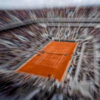 Rebooted Roland Garros struggles to escape shadow of coronavirus