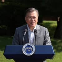 South Korean President Moon Jae-in delivers a speech during Youth Day at the presidential Blue House in Seoul on Saturday. | YONHAP / VIA REUTERS