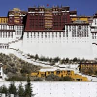 A paramilitary policeman stands guard in front of the Potala Palace in Lhasa, Tibet Autonomous Region, in 2015.  | REUTERS