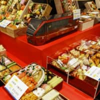 Preparing for the holidays: The Kintetsu department store shows off examples of osechi dishes on offer for the holidays this year. | KYODO