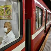 Tokyo reports 59 coronavirus cases as testing drops over holiday