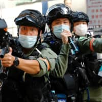 Bloody crackdowns on protests in Hong Kong by Chinese authorities have highlighted Beijing's ambitions both close to home and further afield.   REUTERS