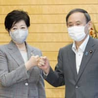 Prime Minister Yoshihide Suga and Tokyo Gov. Yuriko Koike meet Wednesday at the Prime Minister's Office in the capital. | KYODO