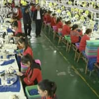 Muslims work in a garment factory at the Hotan Vocational Education and Training Center in Hotan, Xinjiang. | CCTV / VIA AP