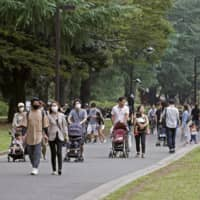 People visit Yoyogi Park in Tokyo on Tuesday, the last day of the four-day holiday. | KYODO