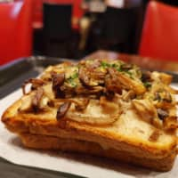 Consistently excellent: Le Pain de Joel Robuchon boasts a croque-monsieur laden with mushrooms, adding earthy, savory notes to balance the bechamel. | PHOEBE AMOROSO