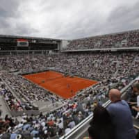 Fans fill Roland Garros during last year's French Open men's singles final on June 9, 2019, in Paris. | AP