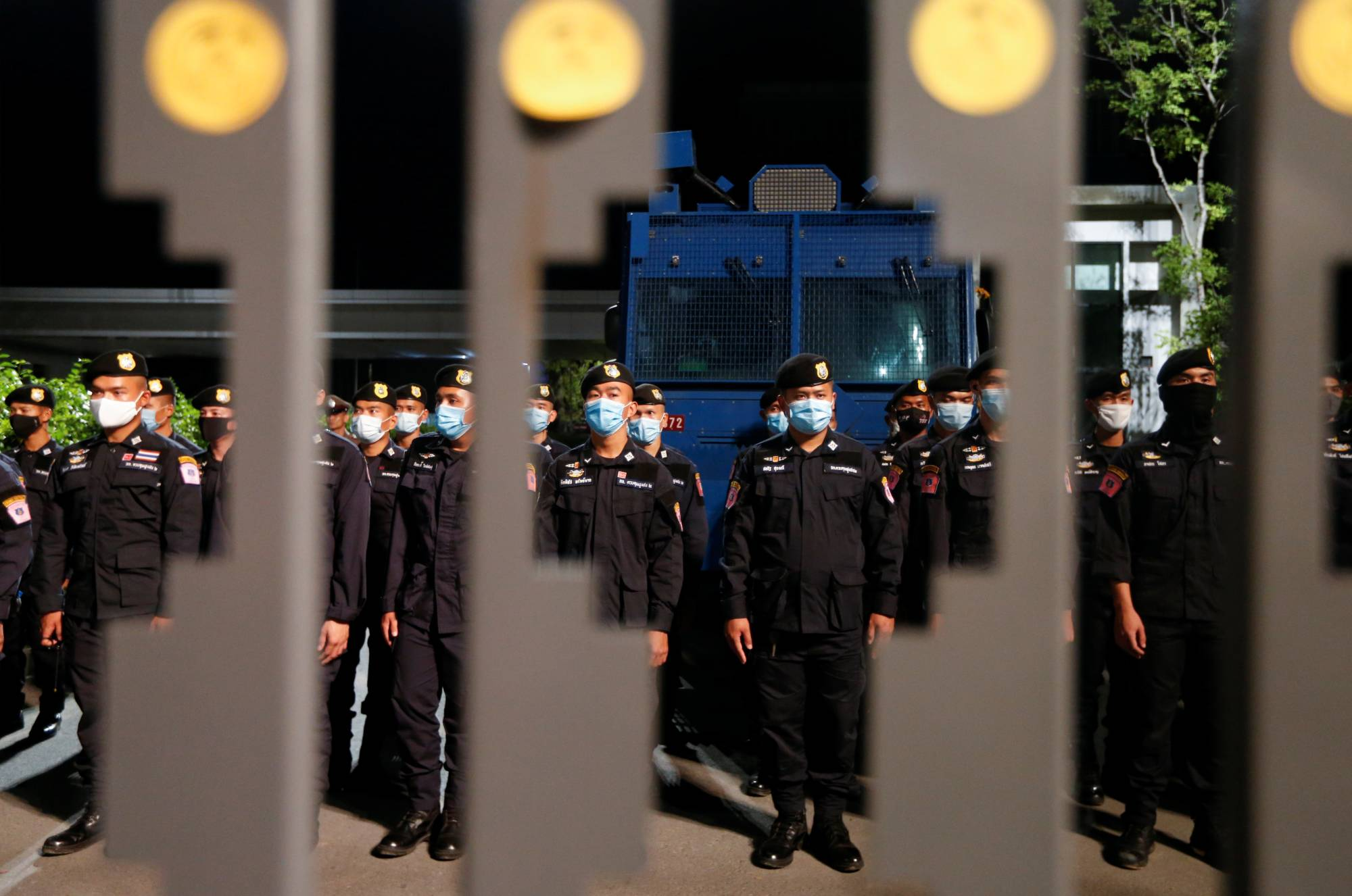 Security officers stand guard as pro-democracy protesters attend a mass rally to call for the ouster of Prime Minister Prayut Chan-ocha and reforms to the monarchy in front of parliament in Bangkok on Thursday. | REUTERS