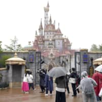 Tokyo Disneyland's new area of attractions is shown to media Friday in Urayasu, Chiba Prefecture, with a new castle seen in the background. | KYODO