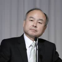 Masayoshi Son cuts SoftBank shares pledged to lenders by $810 million