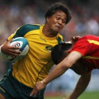 Brackin Karauria-Henry (left), seen representing Australia during the Hong Kong Sevens tournament in March 2010, is one of three players affected by a Japan Rugby Football Union ruling declaring that foreign-born players with Japanese passports will be treated as non-Japanese if they are not eligible to play for the Brave Blossoms. | REUTERS