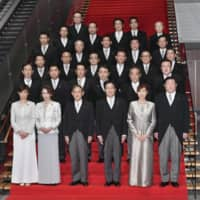Prime Minister Yoshihide Suga's state ministers pose with him for a photo on Sept. 18.  | KYODO