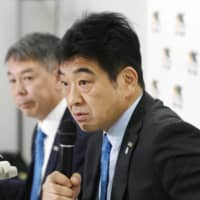 Japan Rugby Top League Chairman Osamu Ota speaks during a news conference on Feb. 26. | KYODO