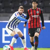 Daichi Kamada (right) competes for Eintracht during a match against Hertha on Friday in Berlin. | KYODO