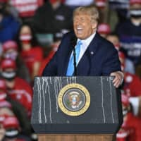 U.S. President Donald Trump speaks during a campaign rally at Harrisburg International Airport on Saturday in Middletown, Pennsylvania.    AP