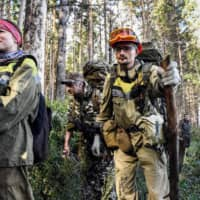 Firefighters take on a blaze in a Suzunsky forest. According to many scientists, Siberia and the Arctic are among the regions most exposed to climate change. | AFP-JIJI