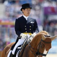 Japan's Hiroshi Hoketsu, the oldest athlete to have taken part in the London Olympics at age 71, rides his chestnut mare Whisper during the individual dressage competition at Greenwich Park in London in August 2012.     | KYODO