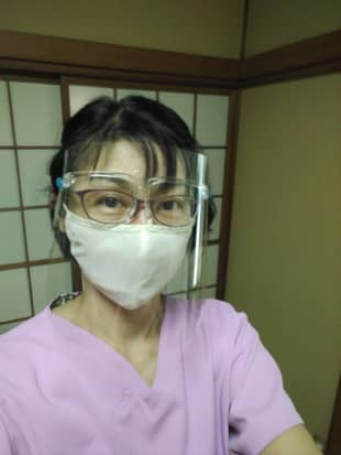 Virus wars: Akiyo Yoshida sports a face shield and face mask when she works with customers these days.