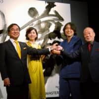 Yuko Takeuchi (second from left) attends a Suntory Beer Ltd. promotional event in Tokyo in March 2015. | KYODO
