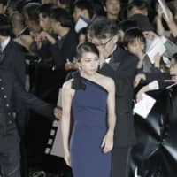 Yuko Takeuchi walks the red carpet at the opening ceremony of the 28th Tokyo International Film Festival in Tokyo's Roppongi district in October 2015. | KYODO
