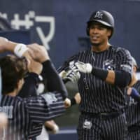 Steven Moya is congratulated by his teammates after hitting a home run for Orix on Sunday. | KYODO