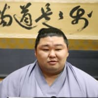 Shodai speaks during an online news conference on Monday. The Kumamoto Prefecture native secured his first top-division title on Sunday at the Autumn Basho. | JAPAN SUMO ASSOCIATION / VIA KYODO