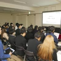 International students attend a job seminar in Tokyo in February. | KYODO