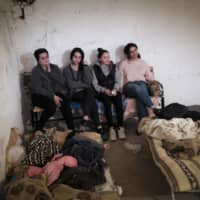 Armenian women sit in a bomb shelter to protect against shelling in Stepanakert, in the self-proclaimed Republic of Nagorno-Karabakh, Azerbaijan, on Monday. | ARMGOV / PAN PHOTO / VIA AP