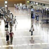 Japan plans to start easing its advisory for travel abroad, starting in October. | KYODO