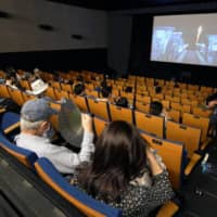The government is considering easing a rule on eating at movie theaters. | KYODO