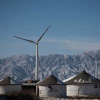 Wind turbines near Beijing. China's surprise pledge to slash its carbon footprint to zero by 2060 has been met with cautious applause. | AFP-JIJI