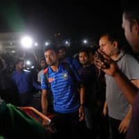 Sabbir Ahmed and other members of Bangladesh's cricket team arrive at Dhaka's Hazrat Shahjalal International Airport from New Zealand on March 16, 2019, one day after narrowly avoiding the Christchurch mosque attack. | REUTERS