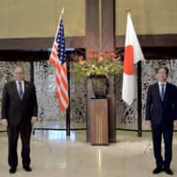 Marshall Billingslea, special U.S. presidential envoy for arms control, and Senior Deputy Minister for Foreign Affairs Takeo Mori pose for a photo ahead of their bilateral meeting at the Foreign Ministry in Tokyo on Tuesday.   POOL / VIA AFP-JIJI