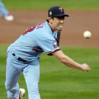 Twins pitcher Kenta Maeda throws to a Tigers batter on Wednesday in Minneapolis. | AP