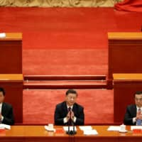 Chinese President Xi Jinping applauds during a meeting at the Great Hall of the People in Beijing on Sept. 8.    REUTERS