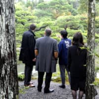 Tranquil escape: Clients of Luxurique, a Japanese concierge company serving VIP travelers, are taken on a garden tour in a private residence in Kyoto in 2018. | COURTESY OF LUXURIQUE / VIA KYODO