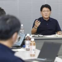 Digital transformation minister Takuya Hirai attends a working session for the launch of the government's digital agency in Tokyo on Sept. 19.   KYODO