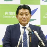 Digital transformation minister Takuya Hirai speaks during a news conference at the Cabinet Office in Tokyo on Sept. 18.   KYODO